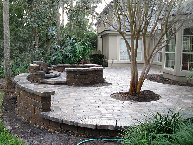 brick paver patio custom firepit retaining wall french doors