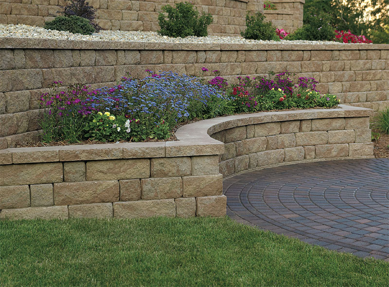 Retaining walls and seating enhance pavers retaining for Block wall landscape design
